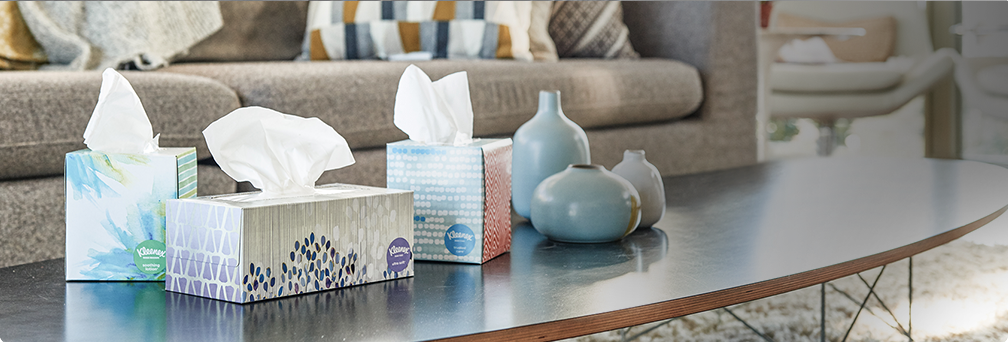Kleenex tissue boxes on a table hero image.