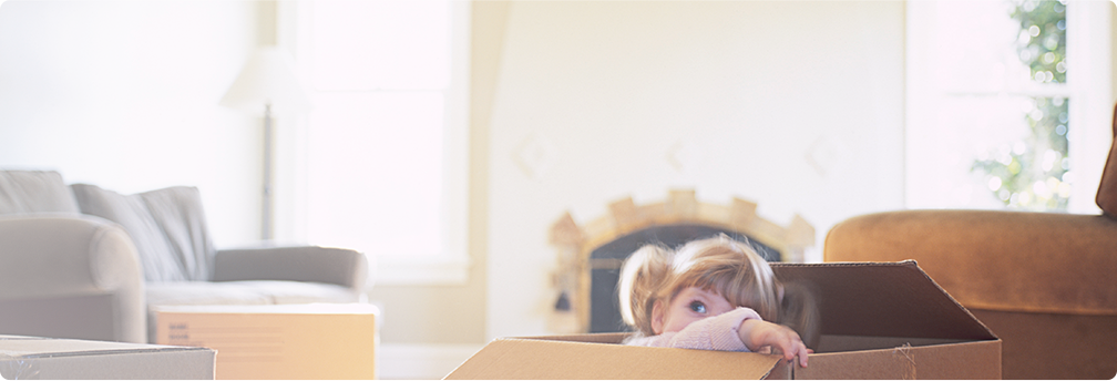 Girl hiding in a cardboard box hero image.